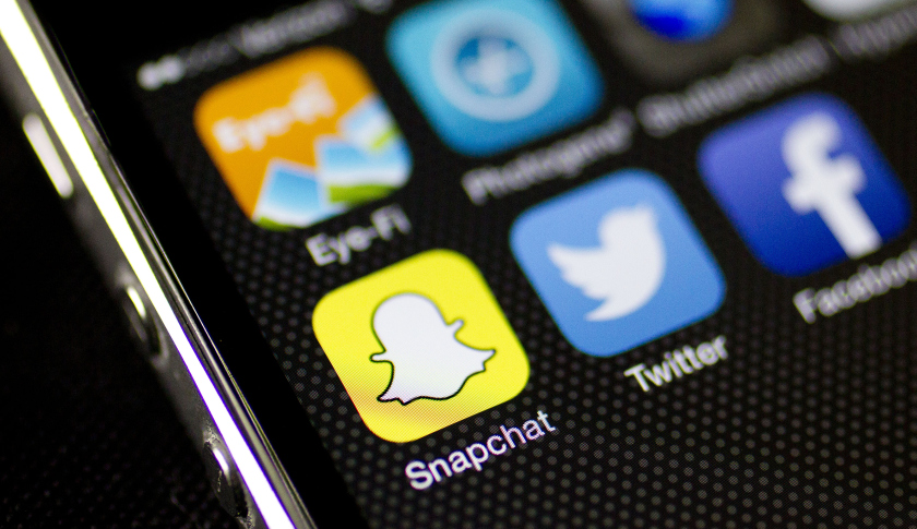 The Snapchat Inc. application (app) is seen on an on an Apple Inc. iPhone 5s displayed for a photograph in Washington, D.C., U.S., on Wednesday, Feb. 18, 2015. Snapchat Inc. is raising money that could value the company at as much as $19 billion. Photographer: Andrew Harrer/Bloomberg via Getty Images
