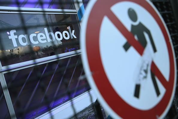 a-no-entry-symbol-hangs-on-an-opened-gate-next-to-the-facebook-logo-at-the-facebook-innovation-hub-on-february-24-2016-in-berlin-germany
